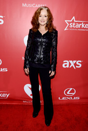 Bonnie Raitt sported a black zip-up jacket with leather leaf appliques during the MusiCares Person of the Year Gala.