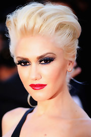 Gwen Stefani paired her smoky lids with a saturated crimson red lip.