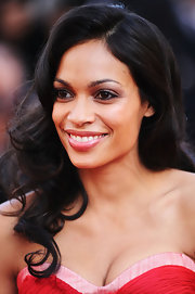 Rosario Dawson styled her brunette tresses in soft elegant curls that were subtly parted on the side.
