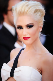 Gwen Stefani styled her platinum blond coif in a soft French twist at the Cannes premiere of 'This Must Be The Piece.'