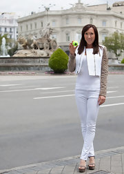 Jelena Jankovic showed off her slim legs in a pair of white skinny jeans at the Madrid Open previews.
