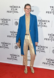 Jenna Lyons teamed gold silk pants with a blue coat for the Tribeca Film Fest premiere of 'My Art.'