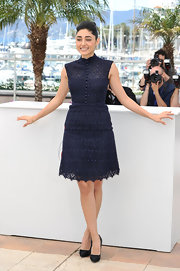 Golshifteh Farahani's navy lace dress gave the actress a lovely daytime look while posing for pictures at Cannes.