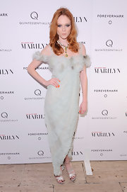 Coco Rocha paired her eggshell gown at the 'My Week With Marilyn Premiere' with a green statement necklace from her charity collection with Senhoa.