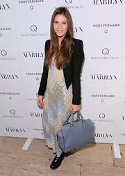 Margherita Missoni tempered her relaxed maxi dress with a sharp black blazer.