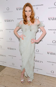 Coco Rocha wore an eggshell cocktail dress with an off-the-shoulder design and draped fit for the 'My Week With Marilyn' premiere.