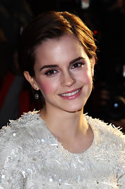 Emma Watson looked adorable at the UK premiere of 'My Week With Marilyn' with her cute crop swept off her face.