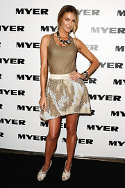 Jennifer Hawkins paired her tan tank top with a sequin skirt.