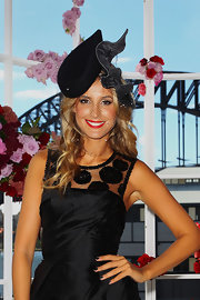 Laura Dundovic wore this fun-looking black decorative hat at the Myer Autumn/Winter Collection preview.