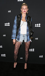 Caroline D'Amore looked grunge chic with this black motorcycle vest paired over a blue plaid shirt.
