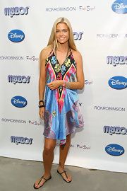Denise opted for casual comfort at the Muppet Myzos event. She paired her printed halter dress with flat sandals.
