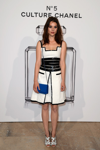 Astrid Berges Frisbey looked tres chic in a black-and-white frock with beaded trim during the No. 5 Culture Chanel exhibition.