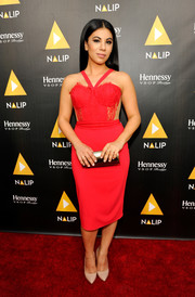 Chrissie Fit paired her lovely dress with a metallic gold clutch.