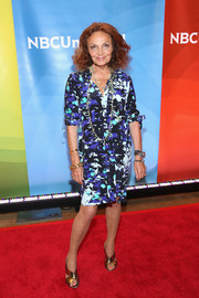 Diane von Furstenberg paired her frock with stylish gold crisscross sandals.