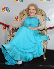 Betty White glittered on her 90th birthday in a shimmering aqua ensemble.
