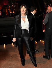 Anjelica Huston was a force to be reckoned with in a sleek black satin suit and a killer statement necklace.