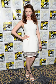 Bitsie kept her look classic and crisp with a sleeveless white frock with a checked under layer.