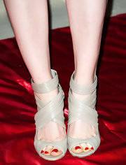Ellie Kemper showed off her red pedicure with these nude strappy sandals while at 'The Office' series finale party.