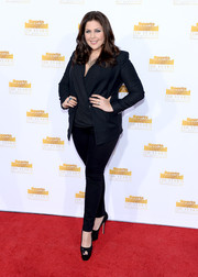 Hillary Scott layered a navy blazer over a wrap top for her red carpet look during the Sports Illustrated Swimsuit Issue 50th anniversary bash.