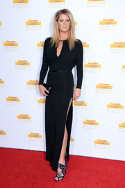 Rachel Hunter went for a bit of sexiness at the Sports Illustrated Swimsuit Issue 50th anniversary bash with this black evening dress featuring an ultra-high slit and a keyhole neckline.