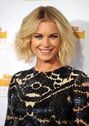 Rebecca Romijn styled her short hair into a cute center-parted wavy 'do for the Sports Illustrated Swimsuit Issue 50th anniversary bash.