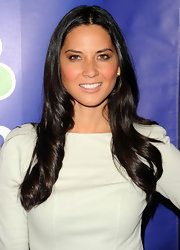 Olivia Munn showed off her long brunette curls while hitting the NBC Upfront Presentation.