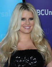 Jessica Simpson attended the NBC Universal 2012 Winter TCA Press Tour All Star Party wearing a sexy sequined dress and her long pale tresses in cascading waves.