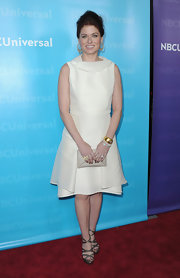 Debra Messing looked chic at the TCA Tour Party in a crisp white A-line dress.