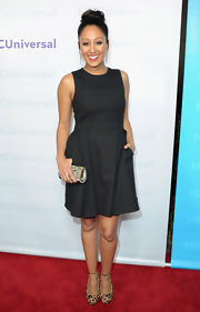 Tamera Mowry wore a black fit-and-flare cocktail dress with pockets for the TCA All-Star Party.