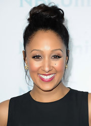 Tamera Mowry wore her hair in an adorable loose bun at the NBC Universal 2012 Winter TCA Press Tour All Star Party.