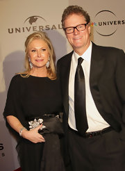 Kathy Hilton's embellished satin clutch was a glamorous complement to her subdued outfit at the Golden Globes after-party.