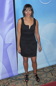 Rashida Jones paired a short black dress with her signature front bangs. Though simple, Rashida made this combo look sophisticated and beautiful.