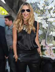 Elle MacPherson looked stylish in her all-black ensemble which she paired with loose blond waves.