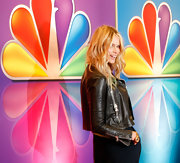 Elle MacPherson topped off her harem pants with this tough leather jacket at the NBC soiree.