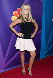 Tamra Barney showed off her curves with a fitted scoop-neck blouse.