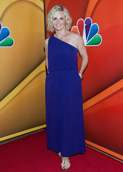 Monica's one-shoulder draped dress in a rich royal purple made her bright blue eyes simply pop.