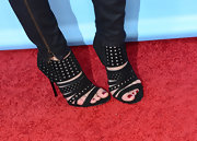 Una Healy chose these black ankle booties with dot cutouts and multiple straps for her red carpet look.