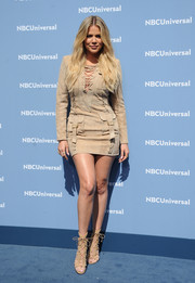 Khloe Kardashian's Christian Louboutin lace-up heels coordinated well with her frock.