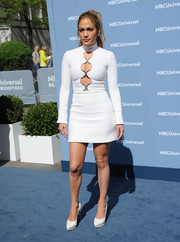 Jennifer Lopez was retro-sexy at the NBCUniversal Upfront in a long-sleeve white turtleneck mini dress with a series of cutouts down the bodice.