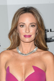 Catt Sadler attended the NBCUniversal Golden Globes after-party sporting a gently wavy, center-parted hairstyle.