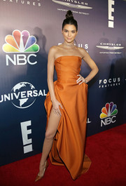 Kendall Jenner matched her frock with a pair of orange python pumps by Christian Louboutin.