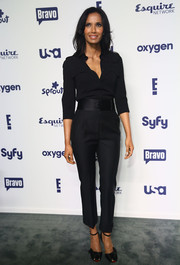A pair of bow-embellished satin sandals added a feminine touch to Padma Lakshmi's menswear-inspired outfit.