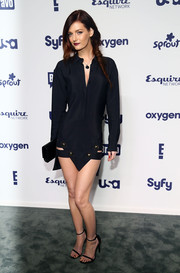 Lydia Hearst showed plenty of thigh at the NBCUniversal Cable Entertainment Upfronts in a short black Anthony Vaccarello shirtdress featuring a geometric hem with cutouts and gold accents.
