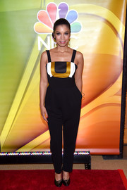 Susan Kelechi Watson kept it breezy at the NBCUniversal Press Junket in a sleeveless black jumpsuit with gold and white accents along the bustline.