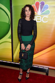 Jennifer Beals paired her top with an embroidered green pencil skirt.