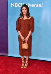 Abigail Spencer kept it demure in a brick-red button-front midi dress with puffed sleeves at the 2018 NBCUniversal Summer Press Day.