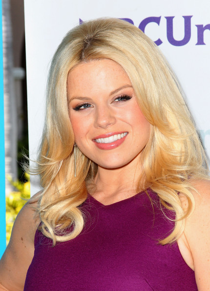 Megan Hilty wore her shiny golden hair in long layers with a lot of volume while attending NBCUniversal Summer Press Day.