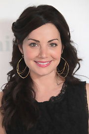 Erica Durance swept her bangs back and wore her pretty waves long and loose while at NBCUniversal Summer Press Day.
