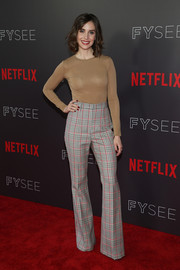Alison Brie looked nearly naked in a body-con tan sweater by Max Mara at the #NETFLIXFYSEE Animation Panel.