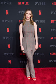 Betty Gilpin matched her top with a pair of glen plaid pants.